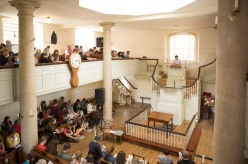 Jeremy Deller taking to the pulpit in the New Room, Bristol. Photo: Max McClure