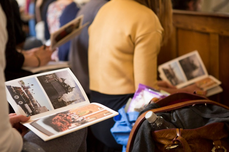 Audience members flicking through Jeremy's accompanying image booklet, much like a sermon, at The New Room, Bristol. Photo: Max McClure