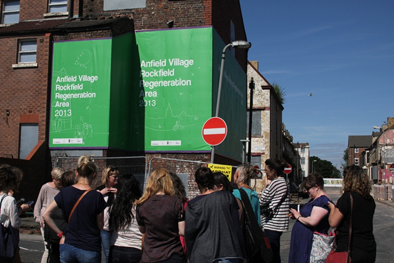 Delegates listen to Jayne Lawless's story outside tinned up streets in Anfield. Photo: Georgina Bolton