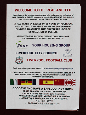 Notice put up on side of 'tinned up' building in the Anfield district. Photo: Georgina Bolton